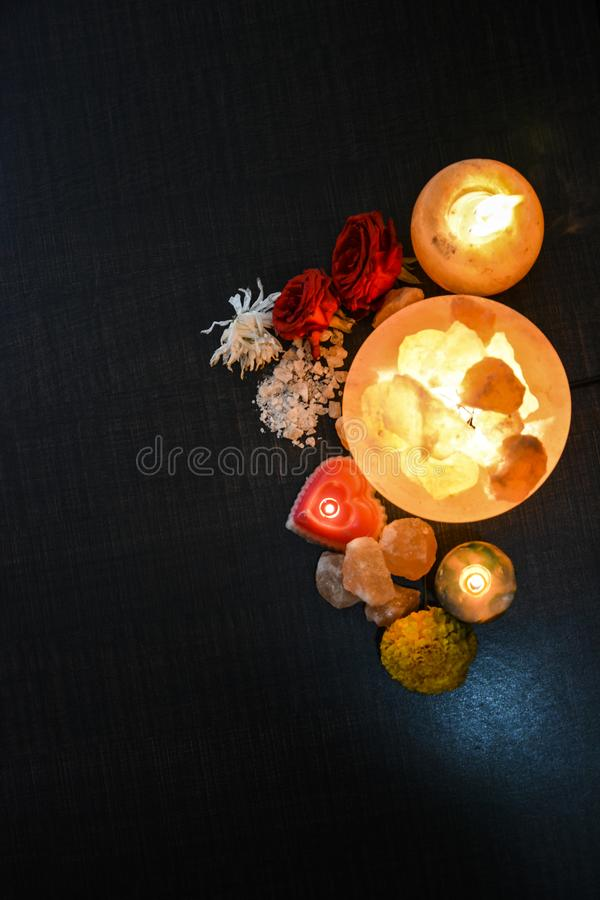 Bowl Chunks Lamps & Natural Salt Candle Holder | Himalayan Salt. Bowl Chunks Lamps & Natural Salt Candle Holder with wooden & black background. Natural salt stock photos