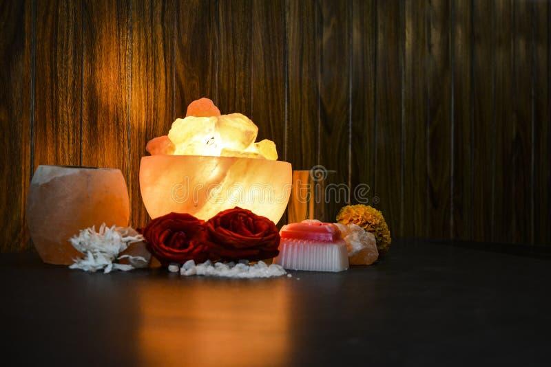 Bowl Chunks Lamps & Natural Salt Candle Holder | Himalayan Salt. Bowl Chunks Lamps & Natural Salt Candle Holder with wooden & black background. Natural salt stock photography
