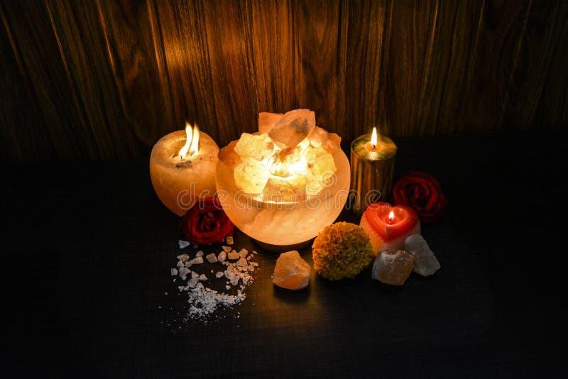 Bowl Chunks Lamps & Natural Salt Candle Holder | Himalayan Salt. Bowl Chunks Lamps & Natural Salt Candle Holder with wooden & black background. Natural salt royalty free stock photography