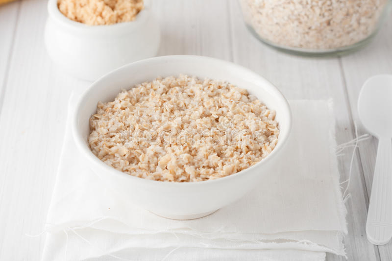 A bowl of cooked oatmeal royalty free stock photography