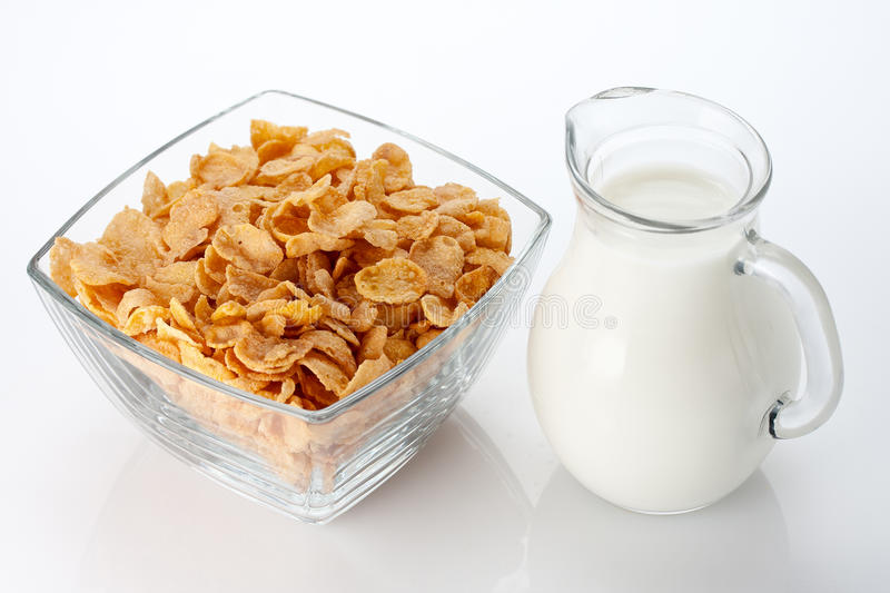 Bowl of cornflakes. In a glass bowl and milk, close up stock photos