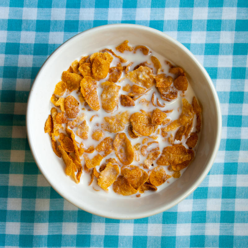 Bowl Of Cornflakes On Blue Gingham Royalty Free Stock Photography