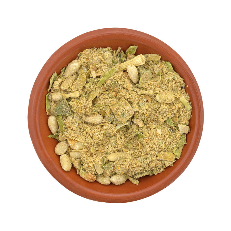 Bowl of couscous with pine nuts and seasonings. Top view of a small bowl with uncooked couscous with pine nuts and seasonings isolated on a white background stock image