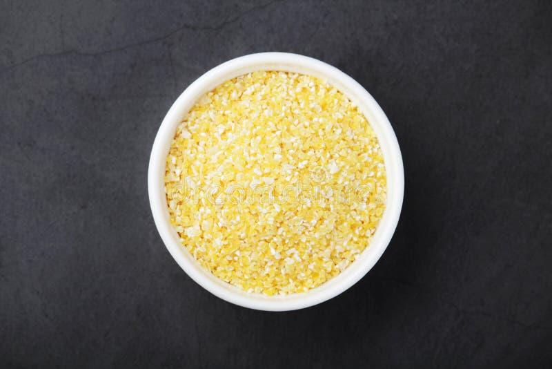 A bowl with crushed maiz stock photos