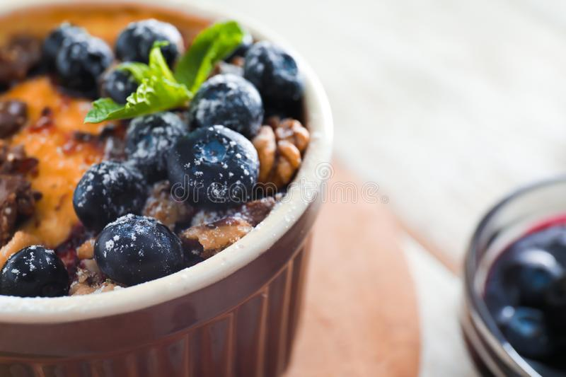 Bowl with delicious blueberry pudding, closeup royalty free stock images
