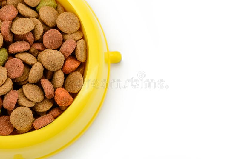 Bowl of dog food. On white background, cropped close up shot. Crunchy multicolor kibbles. Nutrition tips. element for pet blog royalty free stock photos