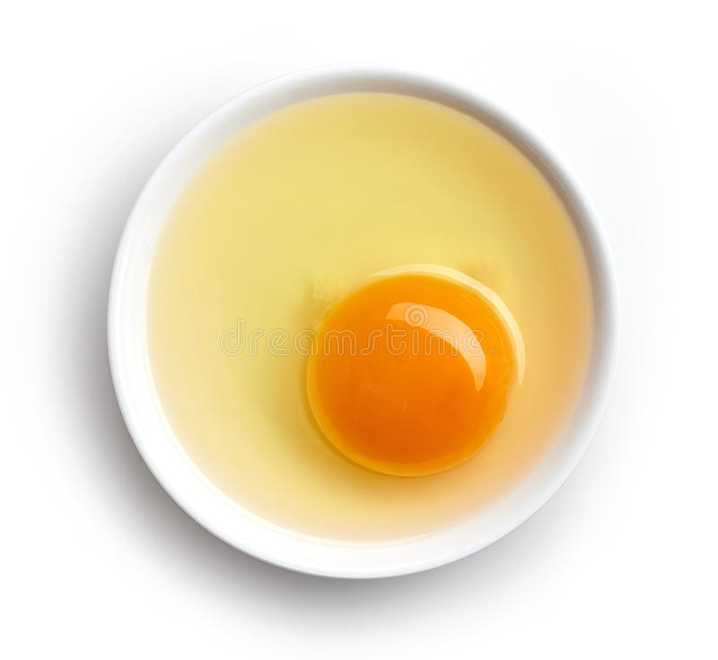 Bowl of egg yolk isolated on white, from above. Bowl of egg yolk isolated on white background, top view stock images
