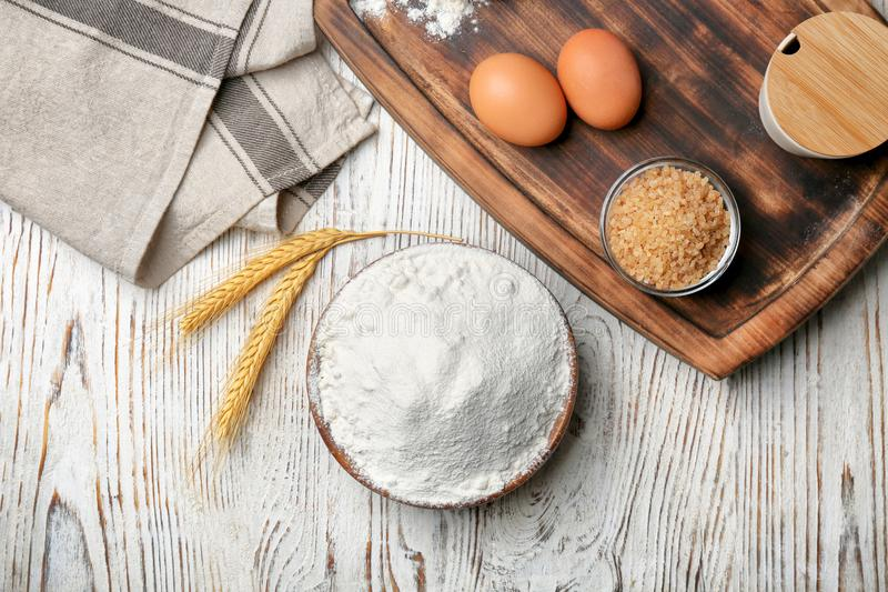 Bowl with flour, eggs and brown sugar royalty free stock photo
