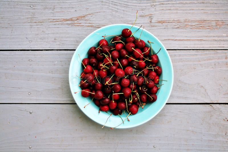 Bowl of fresh cherries stock image
