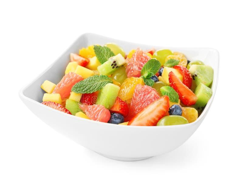 Bowl of fresh fruit salad, isolated royalty free stock photography