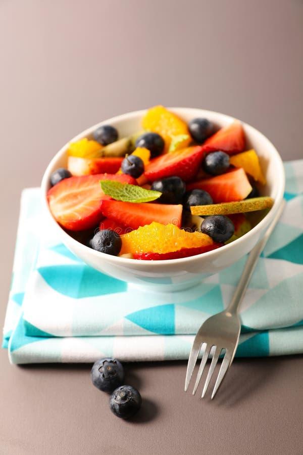 Bowl of fresh fruit salad. Studio shot royalty free stock image