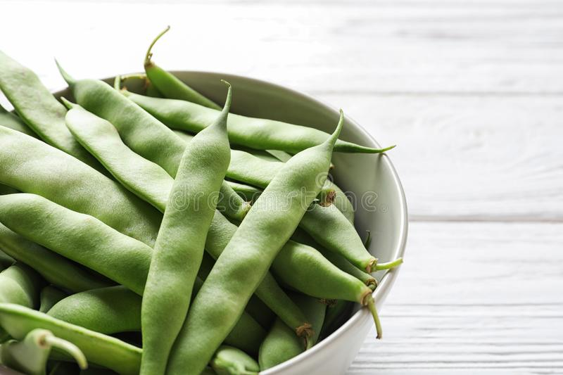 Bowl with fresh green beans royalty free stock photos