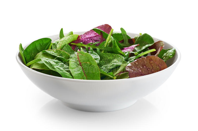 Bowl with fresh green salad isolated on white background (spinac stock photos