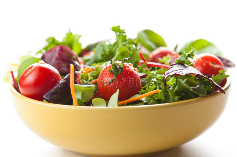 Bowl of fresh green salad with tomatoes stock photos