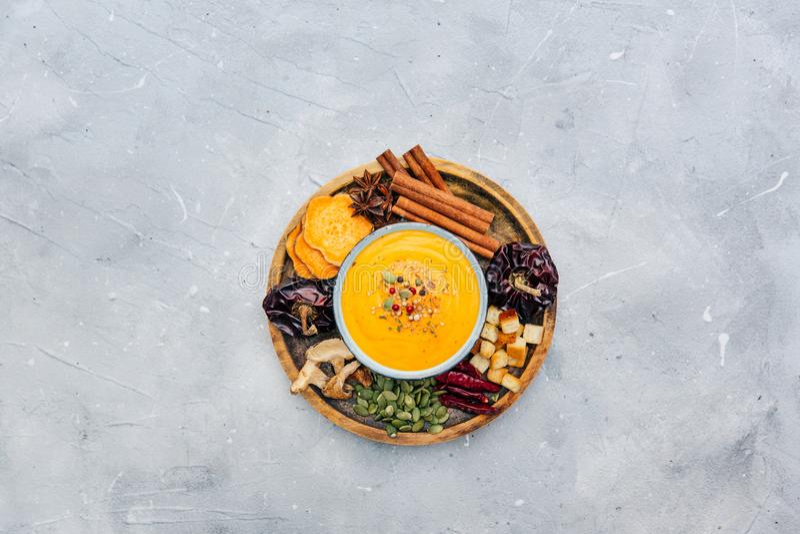 Bowl with fresh homemade sweet potato pumpkin soup stock photography