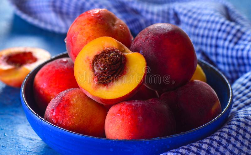 Bowl of fresh peaches for breakfast. Sliced and whole plucked from Aussie orchards stock photo
