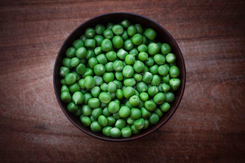 A bowl of fresh peas royalty free stock photos