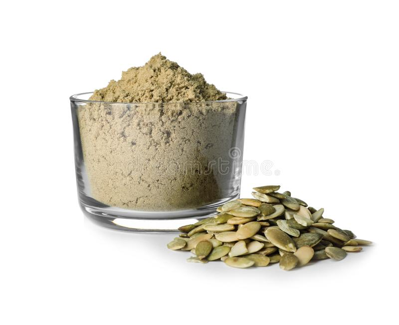 Bowl of fresh pumpkin seed flour and kernels on white royalty free stock photo