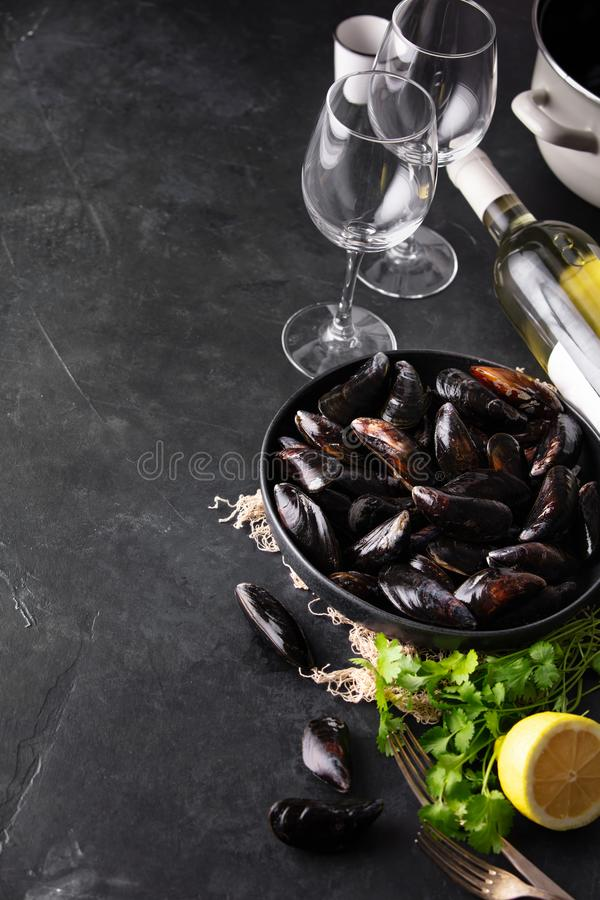 Bowl with fresh raw mussels with white wine, lemon and parsley royalty free stock image