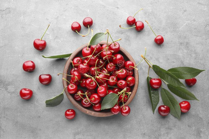 Bowl with fresh ripe cherries stock image