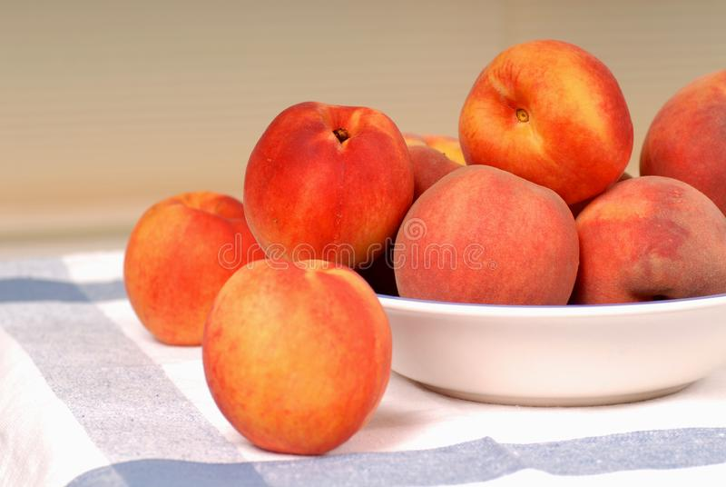 A bowl of fresh ripe peaches stock image