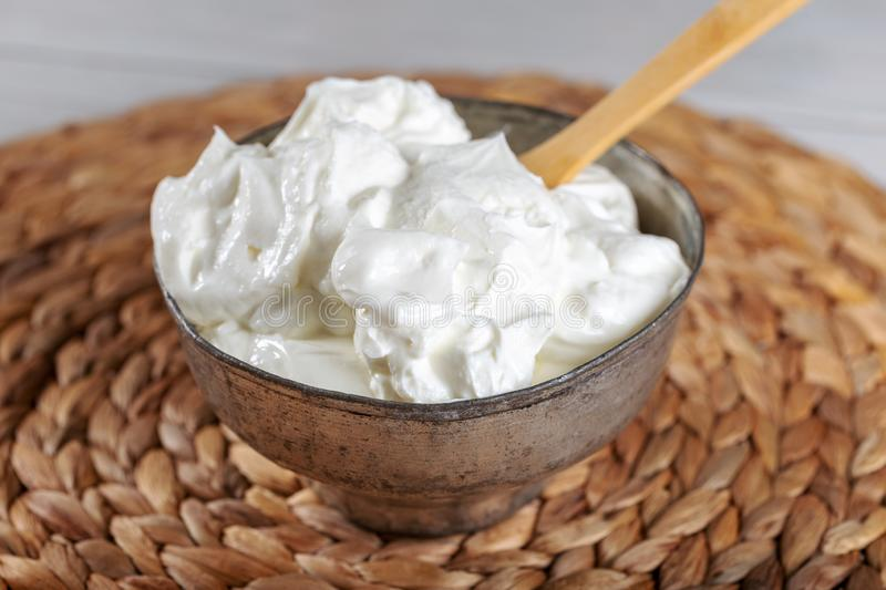 Bowl of fresh strained yogurt. Dairy product. Fresh yoghurt and wooden spoon stock images