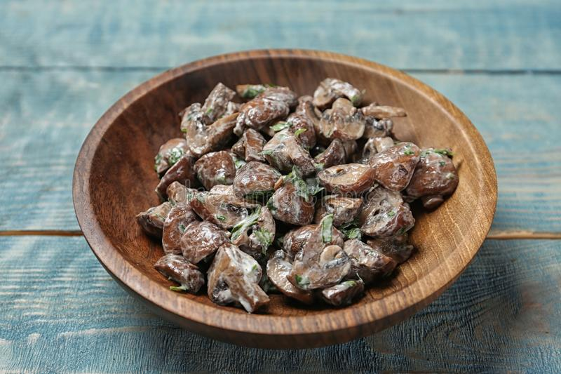 Bowl of fried mushrooms with sauce royalty free stock photography
