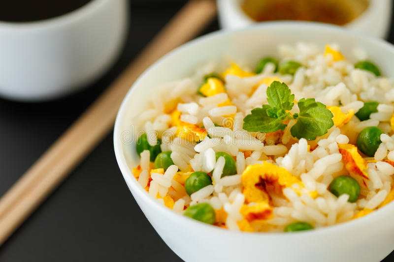 Fried rice. Bowl of fried rice, peas and egg with oyster sauce and aromatic oil royalty free stock photo