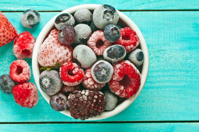 Bowl of frozen berries. Frozen berries royalty free stock images