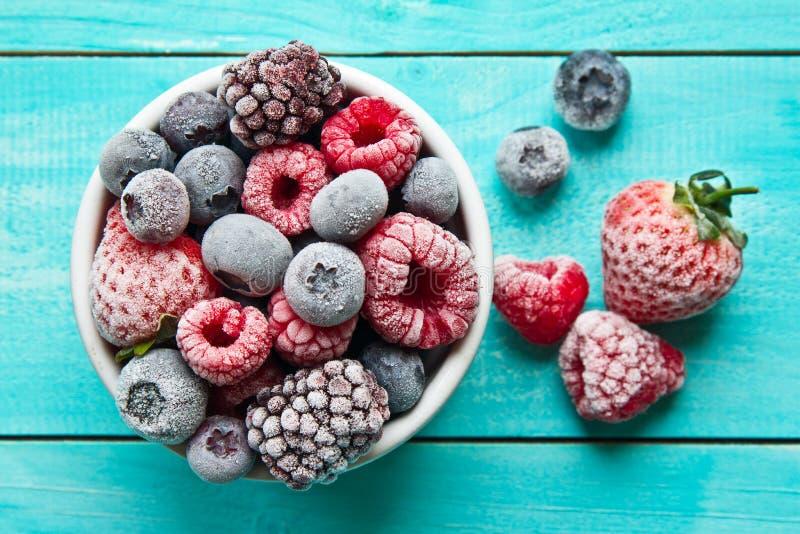 Bowl of frozen berries. Frozen berries stock photo