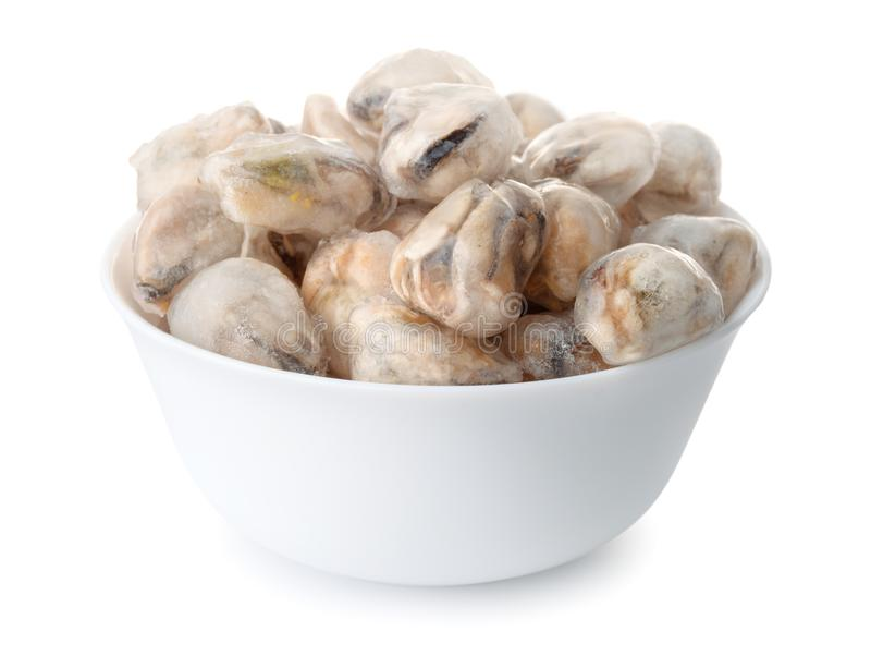 Bowl with frozen cooked mussel meat. Isolated on white stock images