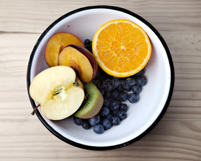 Bowl with fruits royalty free stock photography