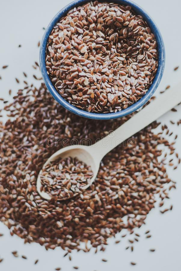 Bowl full of brown flaxseed or linseed. Cereals. Vitamins. Healthy food royalty free stock photos