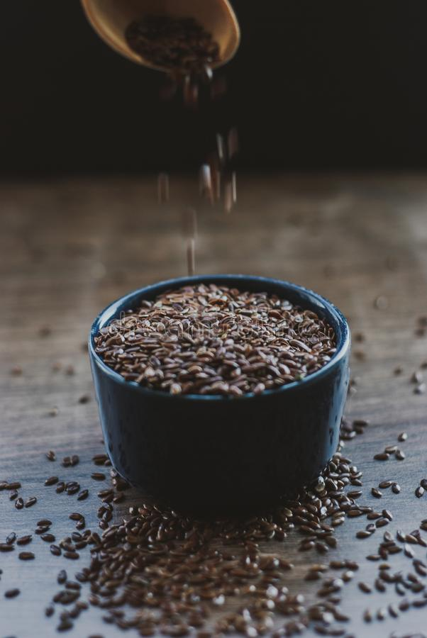 Bowl full of brown flaxseed or linseed. Cereals. Vitamins. Healthy food stock photo