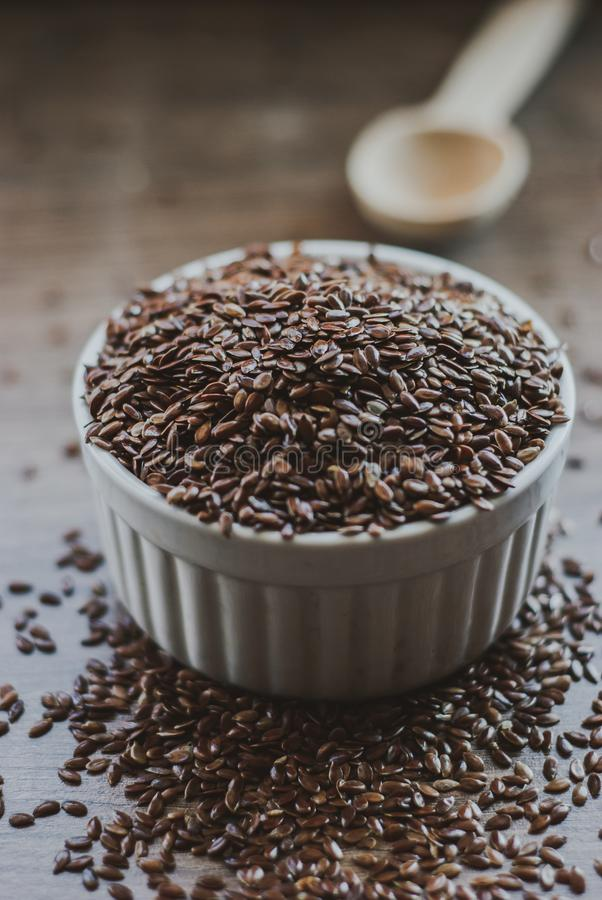 Bowl full of brown flaxseed or linseed. Cereals. Vitamins. Healthy food stock image