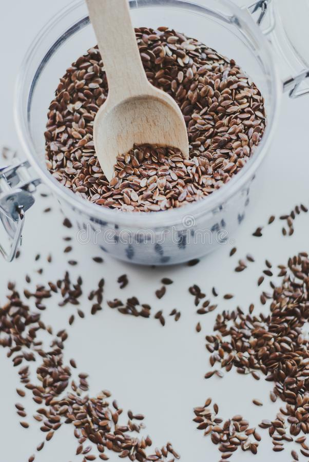 Bowl full of brown flaxseed or linseed. Cereals. Vitamins. Healthy food royalty free stock image