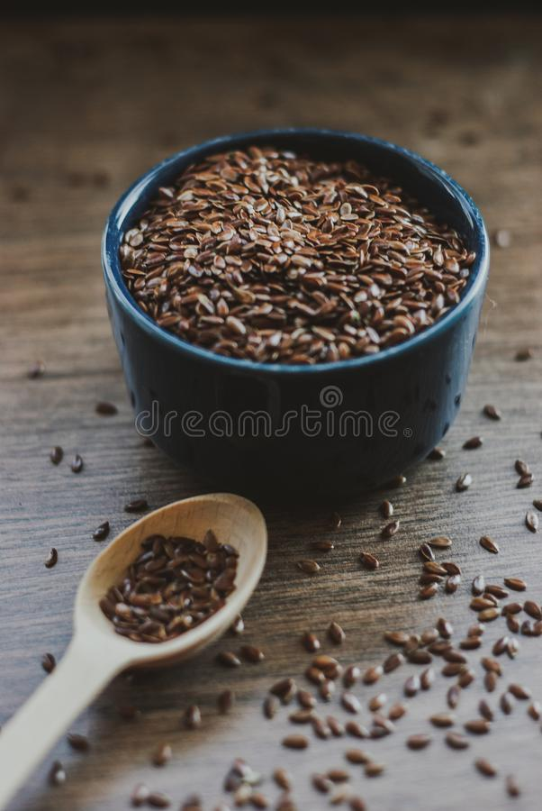 Bowl full of brown flaxseed or linseed. Cereals. Vitamins. Healthy food royalty free stock photo