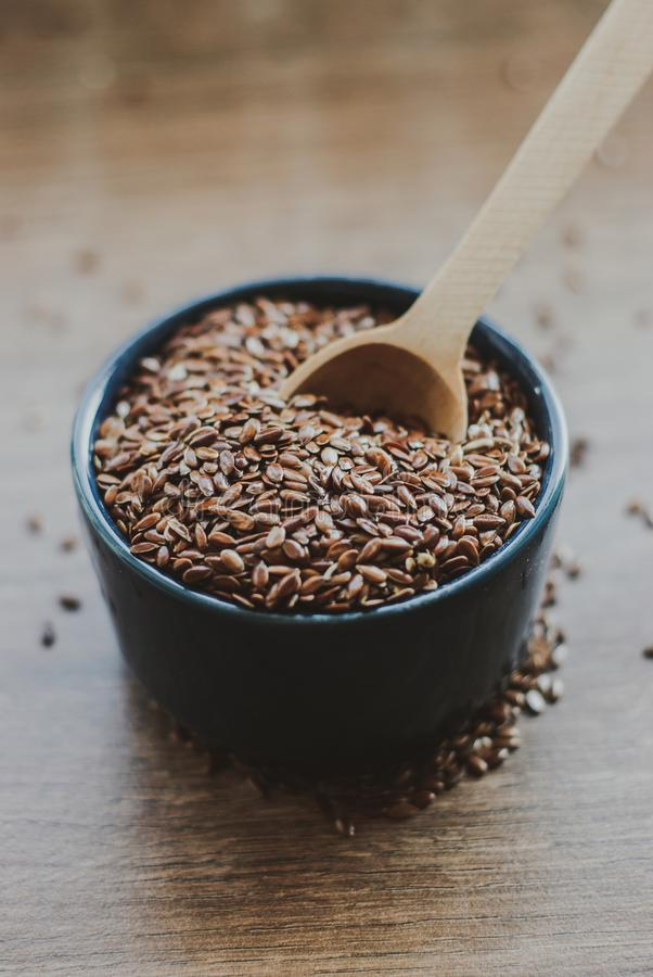 Bowl full of brown flaxseed or linseed. Cereals. Vitamins. Healthy food stock images