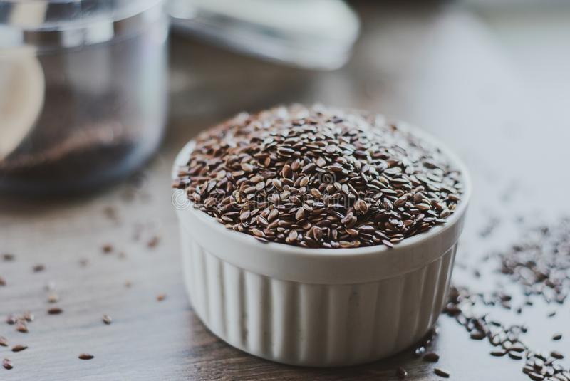 Bowl full of brown flaxseed or linseed. Cereals. Vitamins. Healthy food royalty free stock images