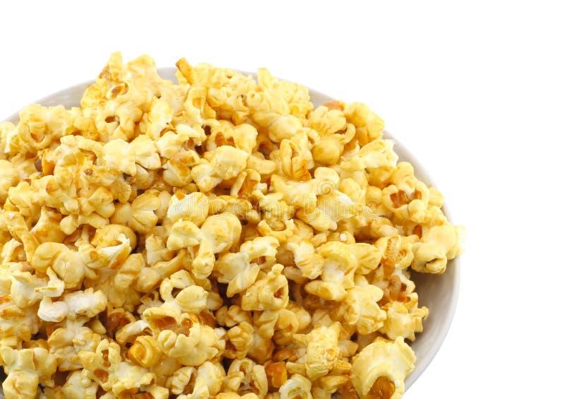 Bowl full of caramel popcorn. Isolated