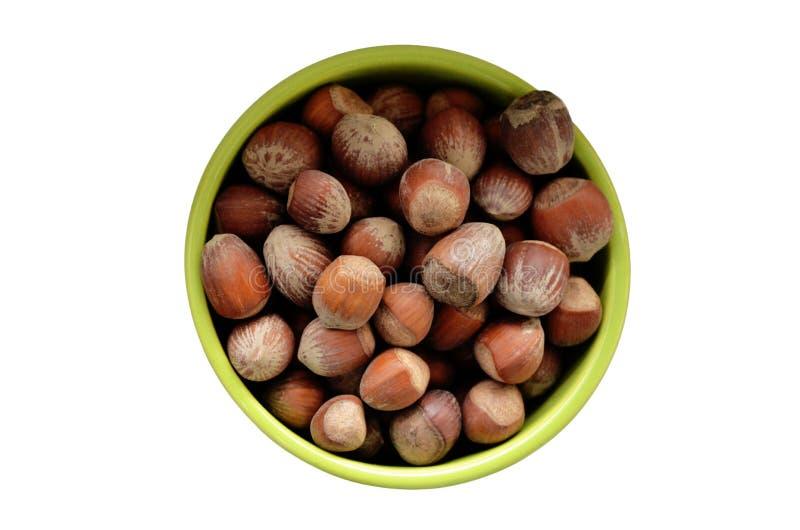 Bowl full of hazelnuts stock photography