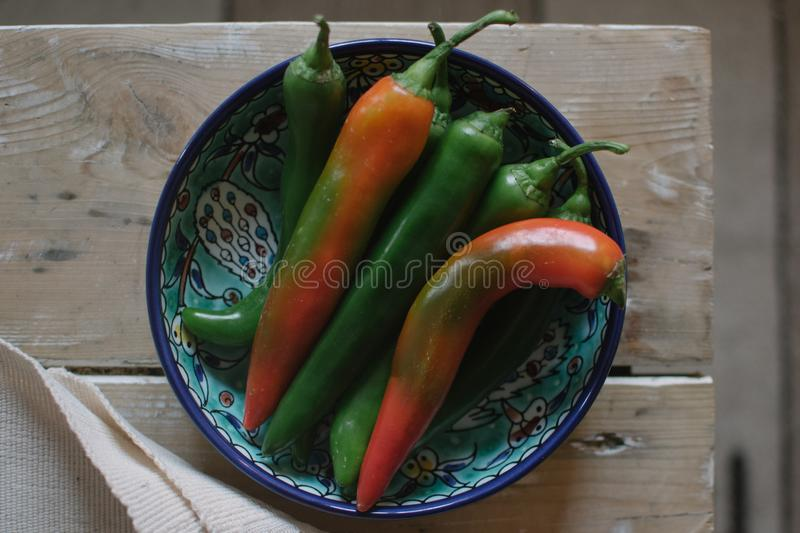 A bowl full of chili peppers stock photo