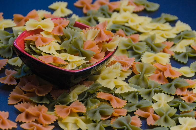 Bowl full of tri colors farfalle pasta royalty free stock image