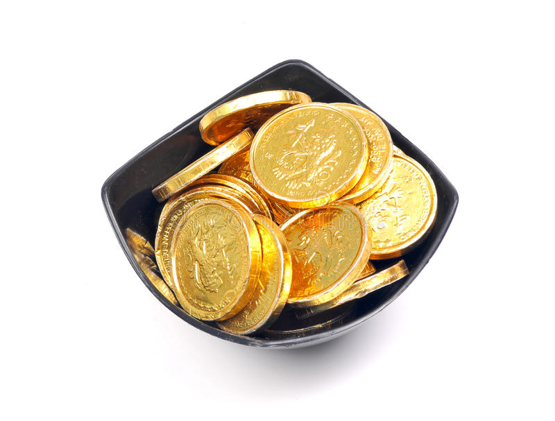 Bowl of gold coins royalty free stock image
