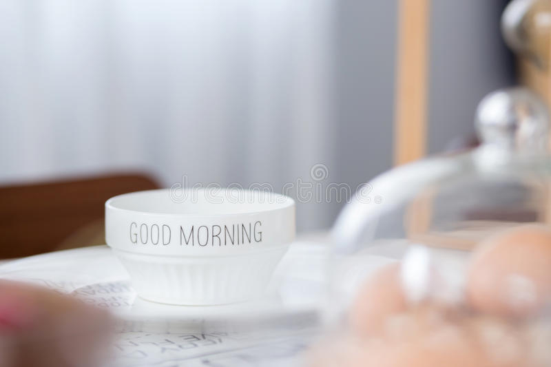 Bowl with good morning text on table. In morning day stock photo
