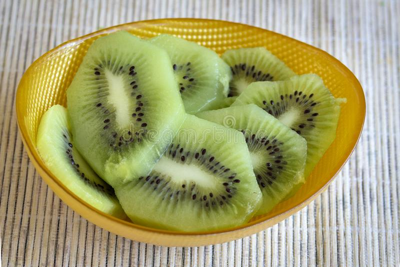 Kiwi in a yellow bowl. stock images