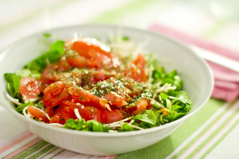 Bowl of green salad and tomatoes