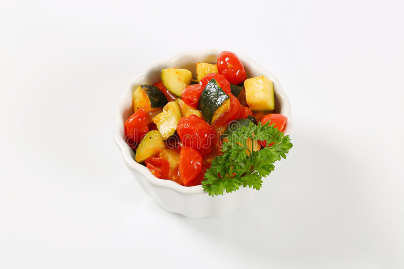 Bowl of grilled vegetables. On white background stock photos