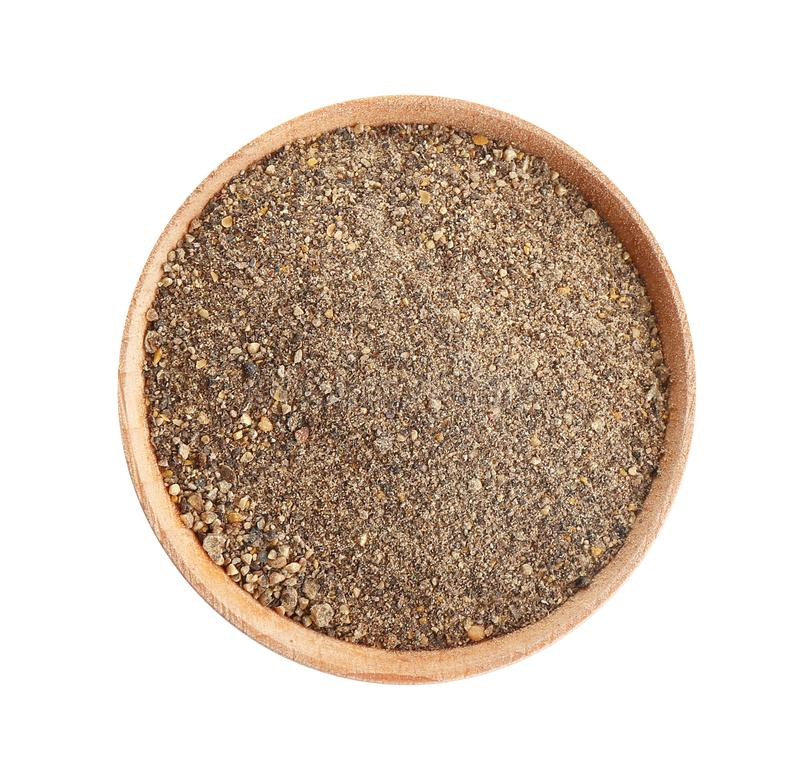 Bowl of ground black pepper isolated on white royalty free stock images
