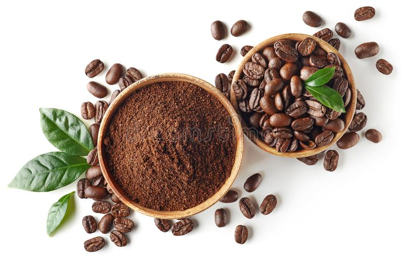 Bowl of ground coffee and beans isolated on white background. Top view stock images
